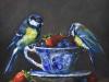 Olieverf-koolmeesjes-op-een-kop-en-schotel-met-fruit (Verkocht)